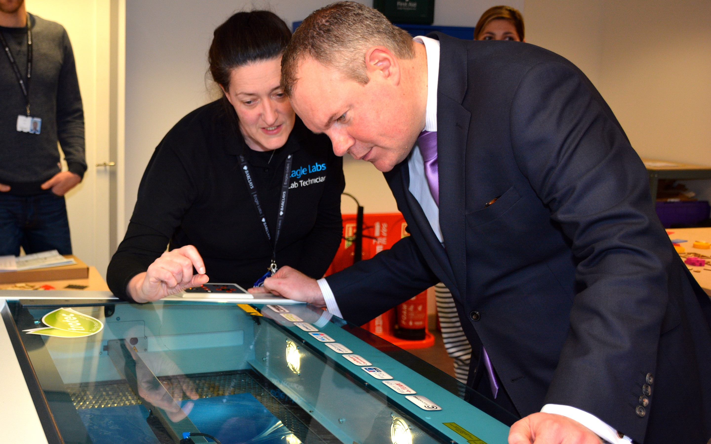 Conor Burns MP using the Eagle Lab's laser cutter.