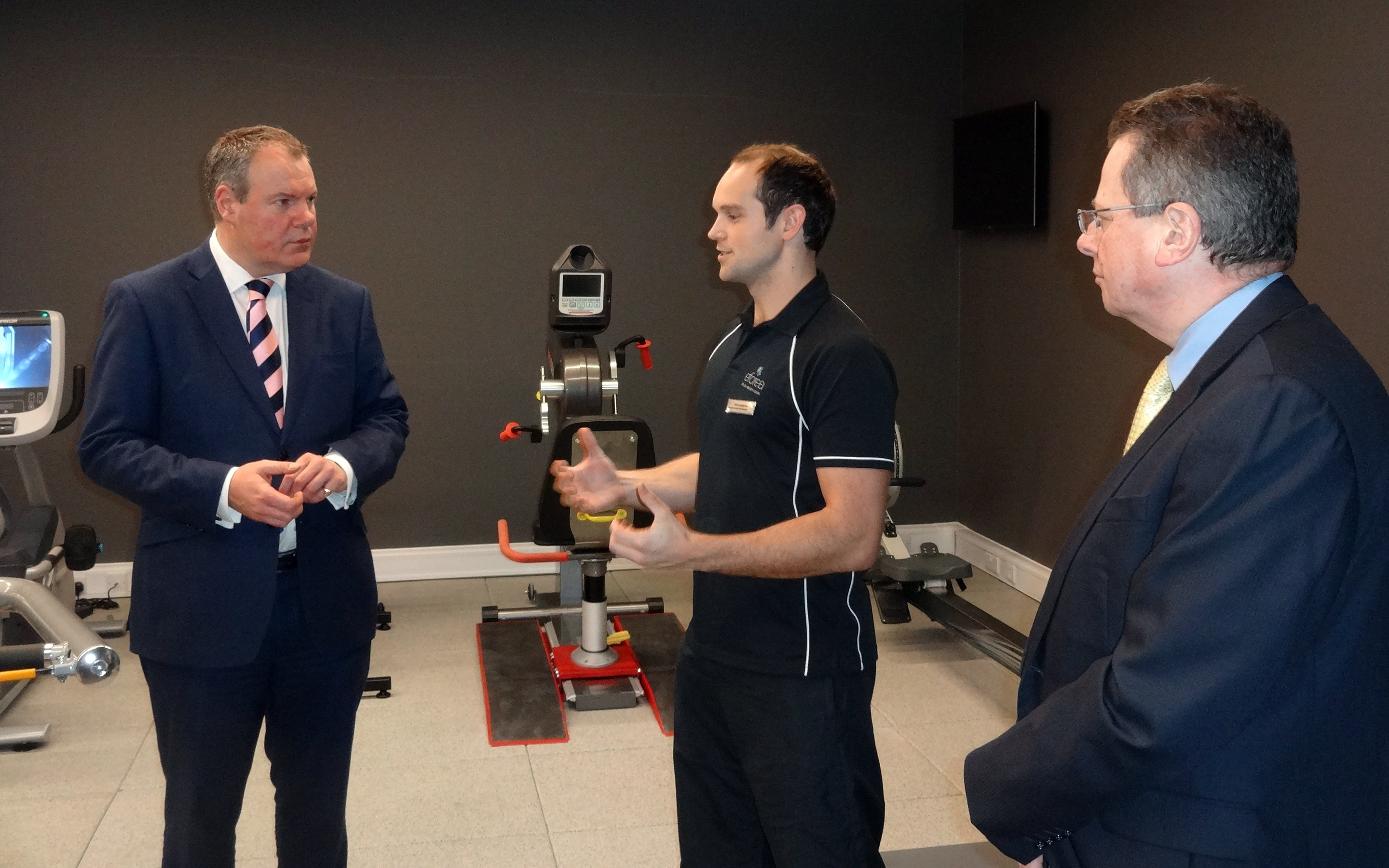Conor Burns MP and Cllr John Beesley are shown the Hilton's fitness suite.