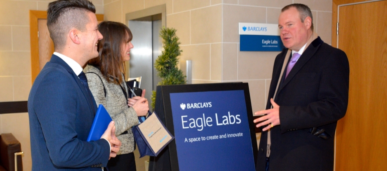 Conor Burns MP speaking with Eagle Lab staff.
