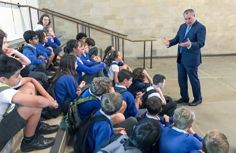 Conor answering questions from St. Michael's School pupils during their visit to Parliament.