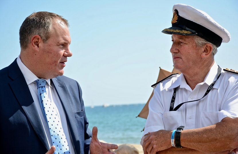 Conor with Commodore Jamie Miller of the Royal Navy on Bournemouth beach. Commodore has coordinated the Navy's role in the Air Festival since the start and will retire this month.