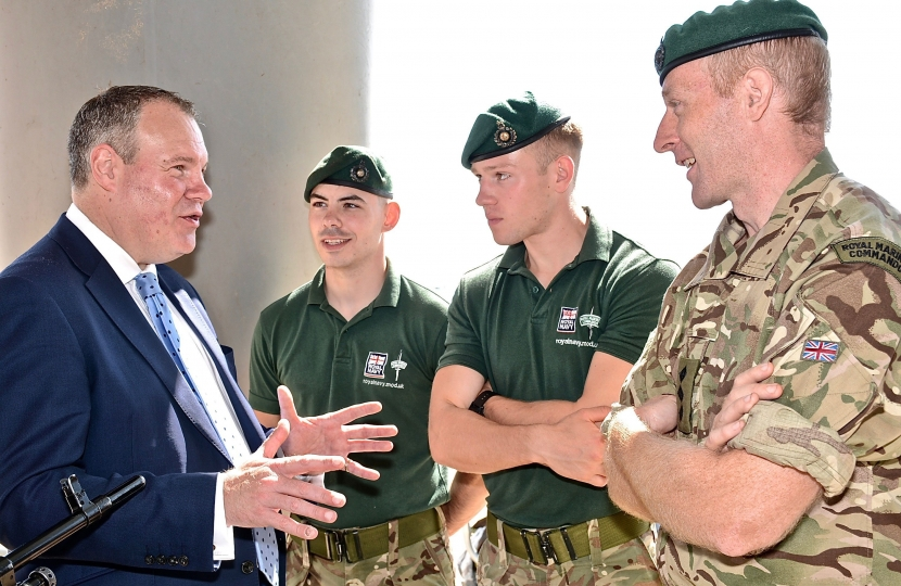 Conor pictured talking with three marines on Bournemouth beach.
