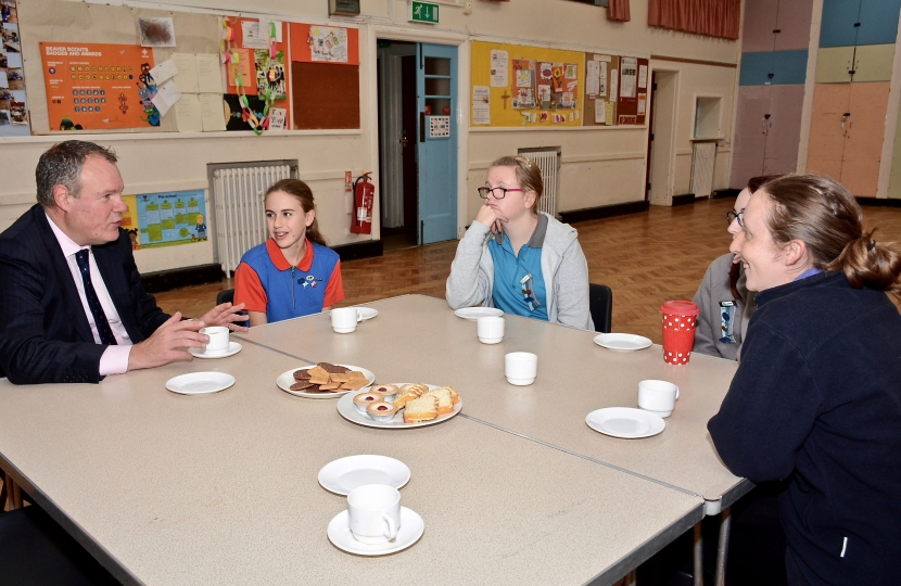 Conor pictured speaking with the Girl Guides about Parliament what an MP does.