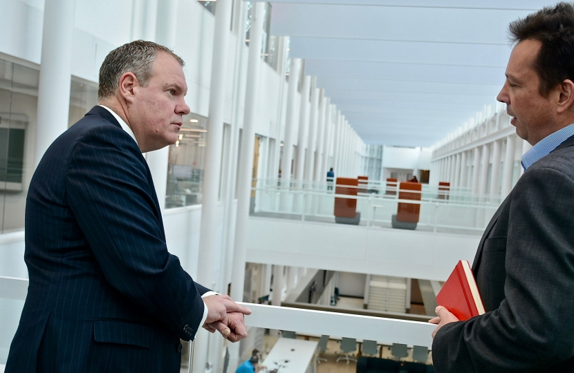 Conor pictured speaking with Gary Ford (Technology Managing Director) overlooking the JP Morgan atrium.