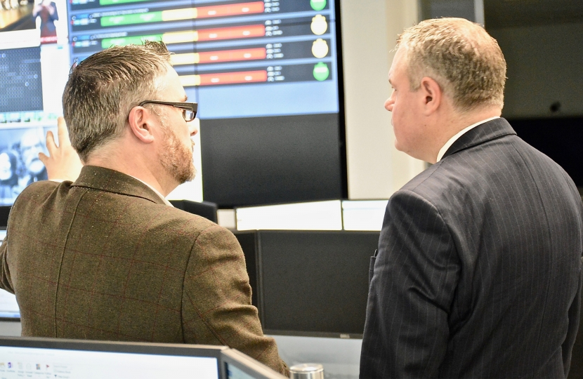 Conor pictured being shown the Command Centre.