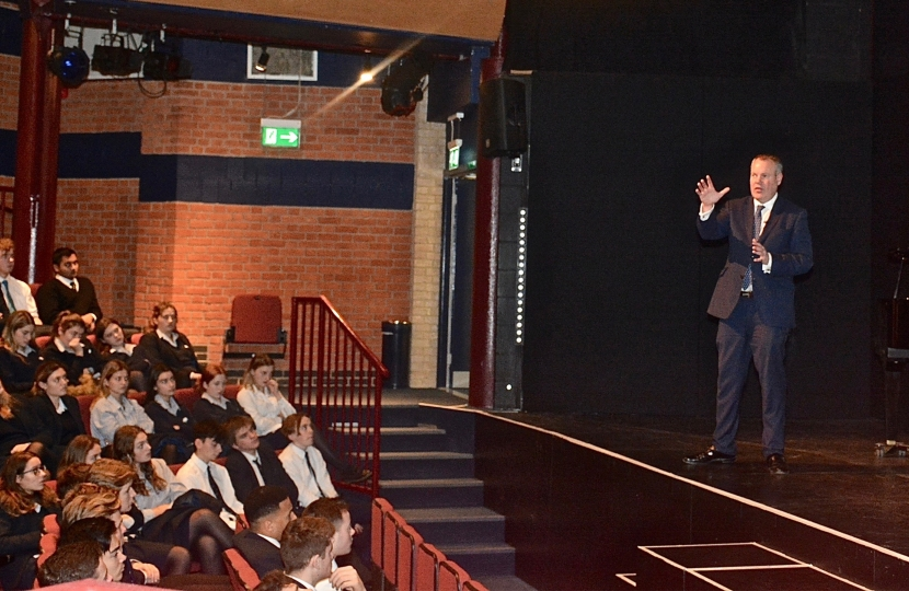 Conor pictured giving a speech to Canford School students about his role as an MP.