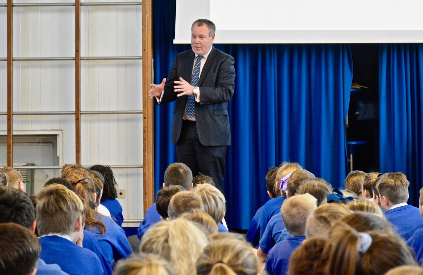 Conor pictured talking to Key Stage 2 students in assembly about the role of an MP.