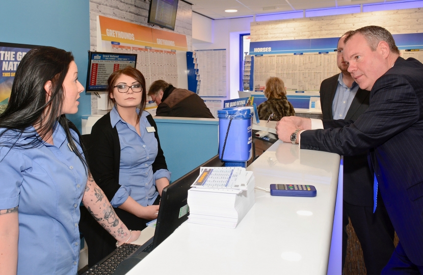 Conor pictured talking to Coral Bet shop staff about the Grand National.