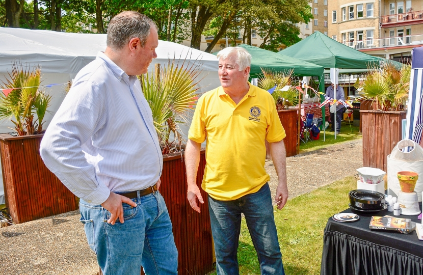 Conor pictured talking amongst the vendors at the fete.