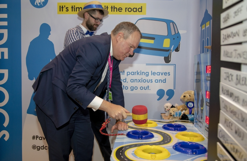 Conor participating in the Guide Dogs' specially-themed whack-a-mole game to illustrate the problem of pavement parking.