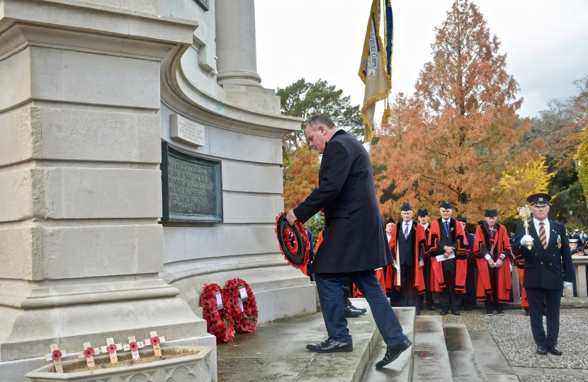 Conor lays a wreath at the war memorial on Remembrance Sunday.