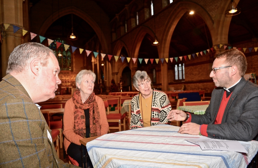 Conor chats to the Revd Michael Smith and members of the Parish Church Council.