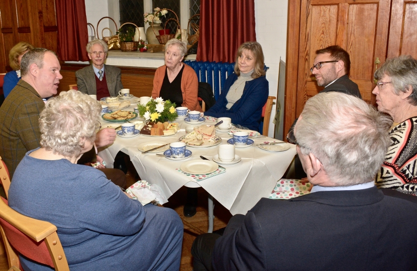 Conor enjoys a traditional afternoon tea with the Revd Michael Smith and members of the Parish Church Council.