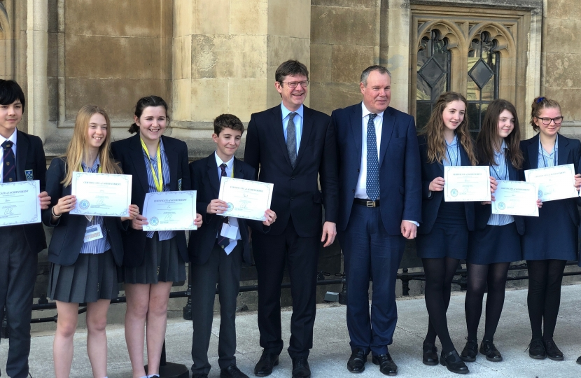 Pupils are presented with their certificates by Conor and the Secretary of State.