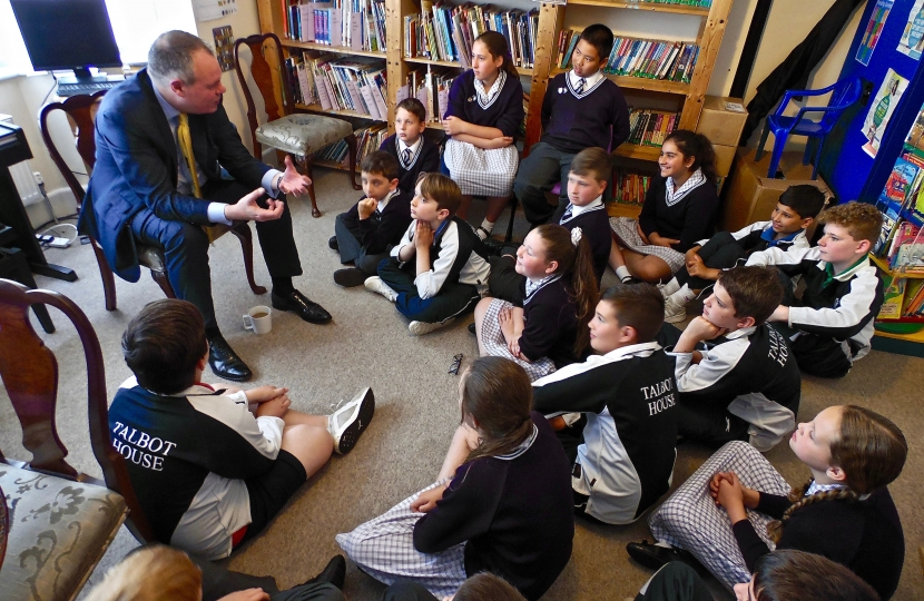 Conor speaking with pupils at Talbot House School.