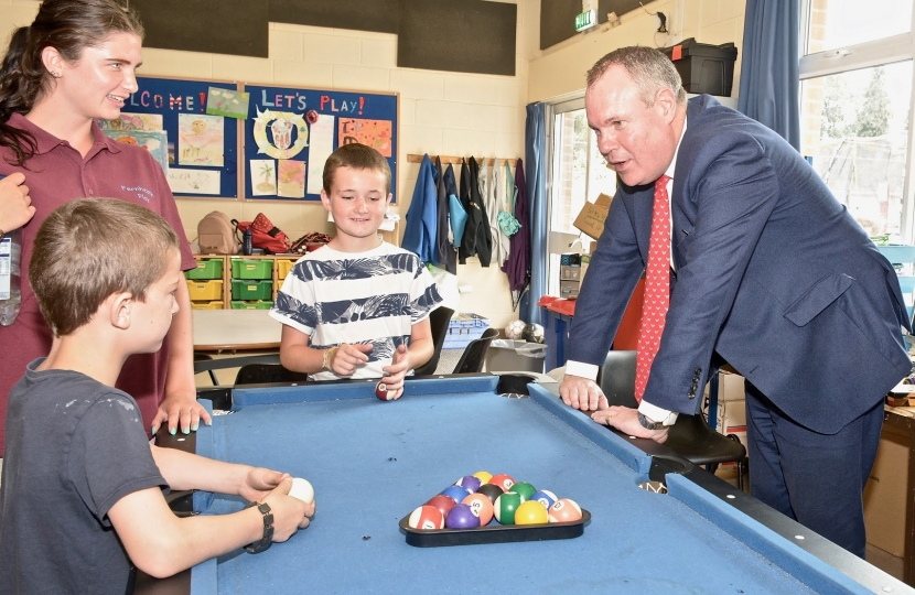 Conor chatting to some of the children who use the Fernheath Play centre over a game of pool.