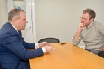 Conor discussing how to best help those with addictions with Bournemouth YMCA CEO Dr Gareth Sherwood.
